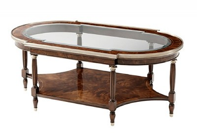 BRASS BOUND BREAKFRONT OVAL COCKTAIL TABLE